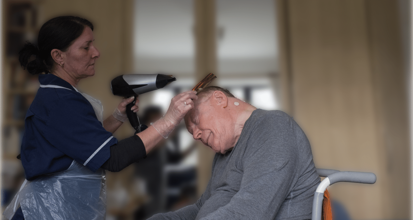 home care worker providing domiciliary care at home